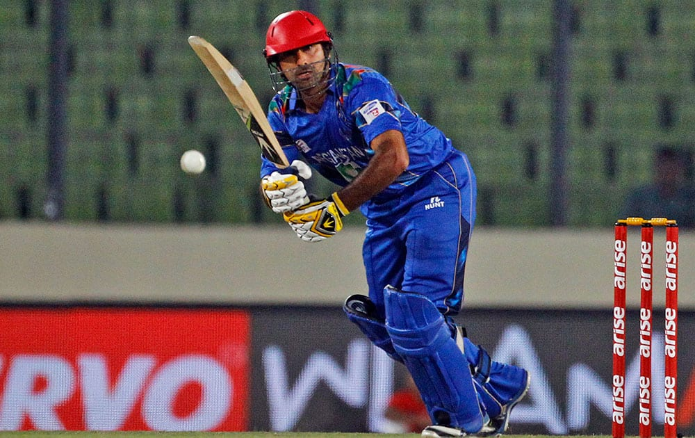 Afghanistan's Asghar Stanikzai plays a shot during the Asia Cup one-day international cricket tournament between them and Sri Lanka in Dhaka, Bangladesh.