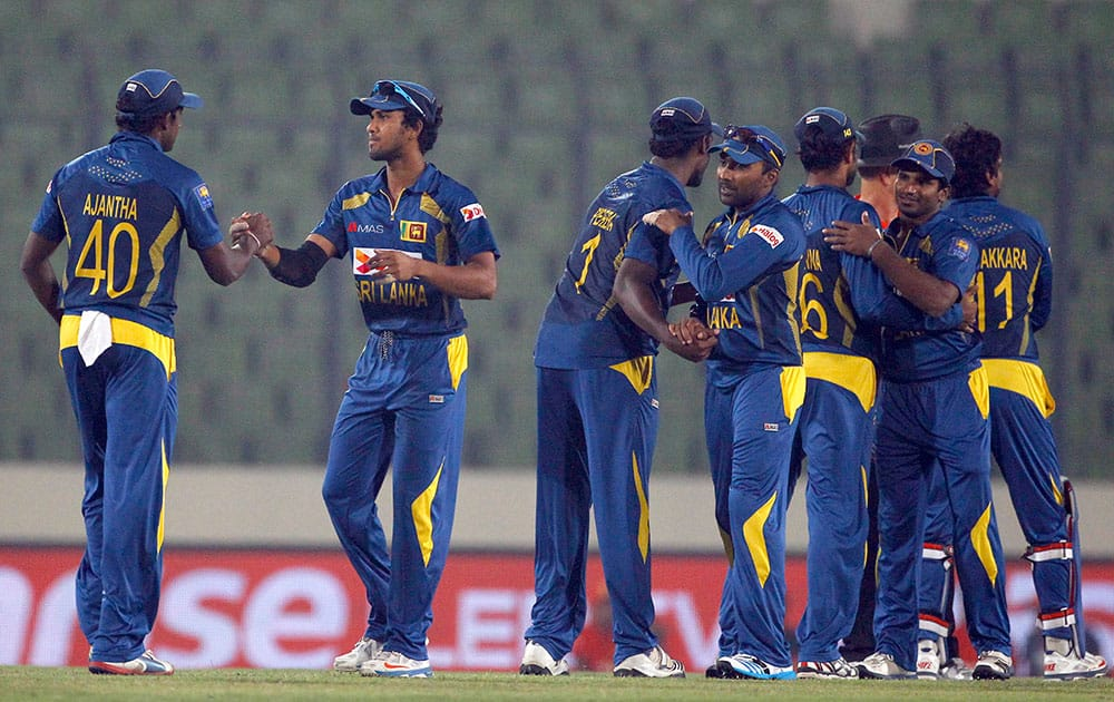 Sri Lankan players celebrate their win over Afghanistan during the Asia Cup one-day international cricket match in Dhaka, Bangladesh.