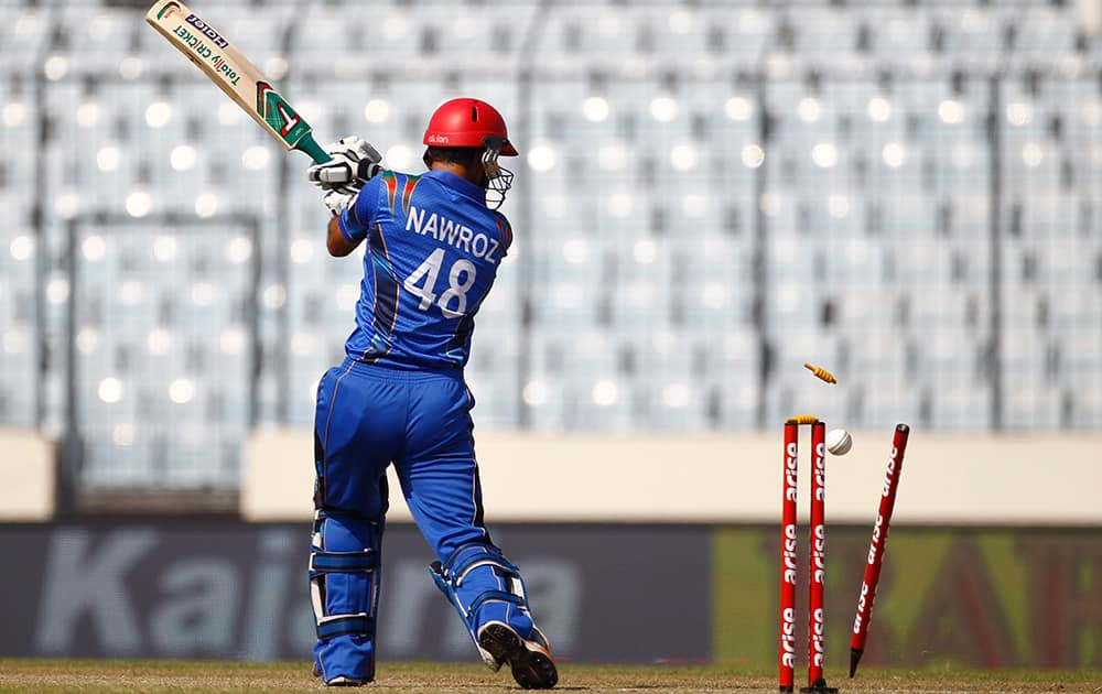 The bails fly off the wickets resulting in the dismissal of Afghan cricket player Nawroz Mangal during the Asia Cup one-day international cricket tournament against India in Dhaka, Bangladesh.