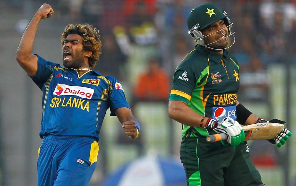 Sri Lanka's Lasith Malinga celebrates taking the wicket of Pakistan's Umar Akmal during their Asia Cup final cricket match in Dhaka, Bangladesh.