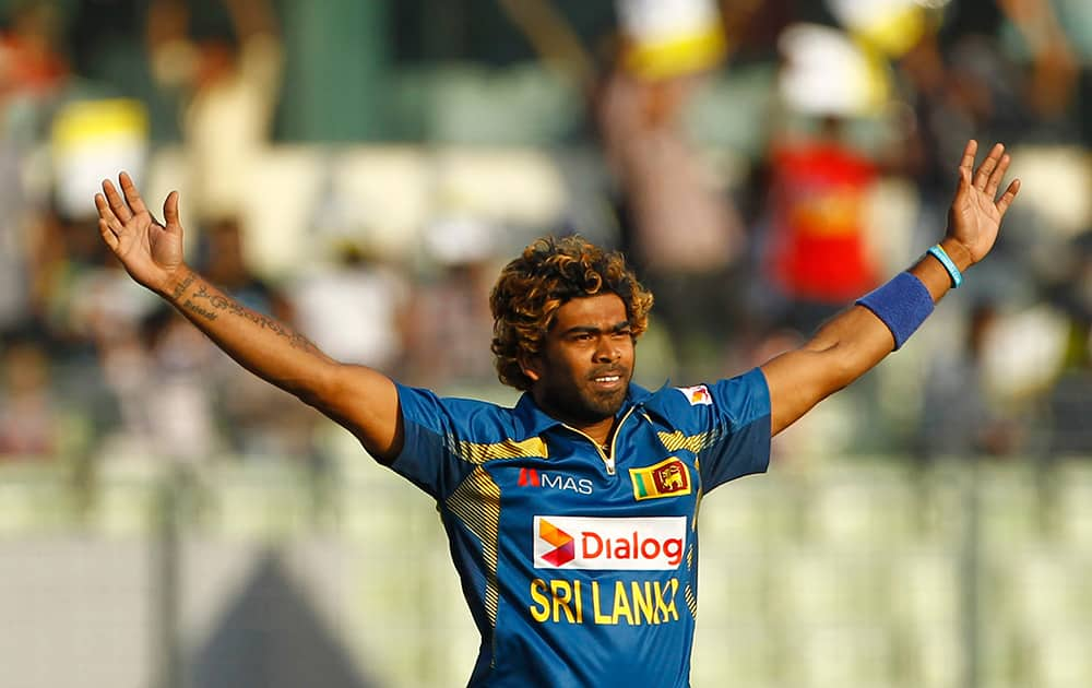 Sri Lanka's Lasith Malinga celebrates taking the wicket of Pakistan's captain Misbah-ul-Haq during their Asia Cup final cricket match in Dhaka, Bangladesh.