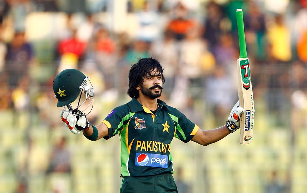 Pakistan's cricket player Fawad Alam celebrates after scoring a century against Sri Lanka during their Asia Cup final cricket match in Dhaka, Bangladesh.