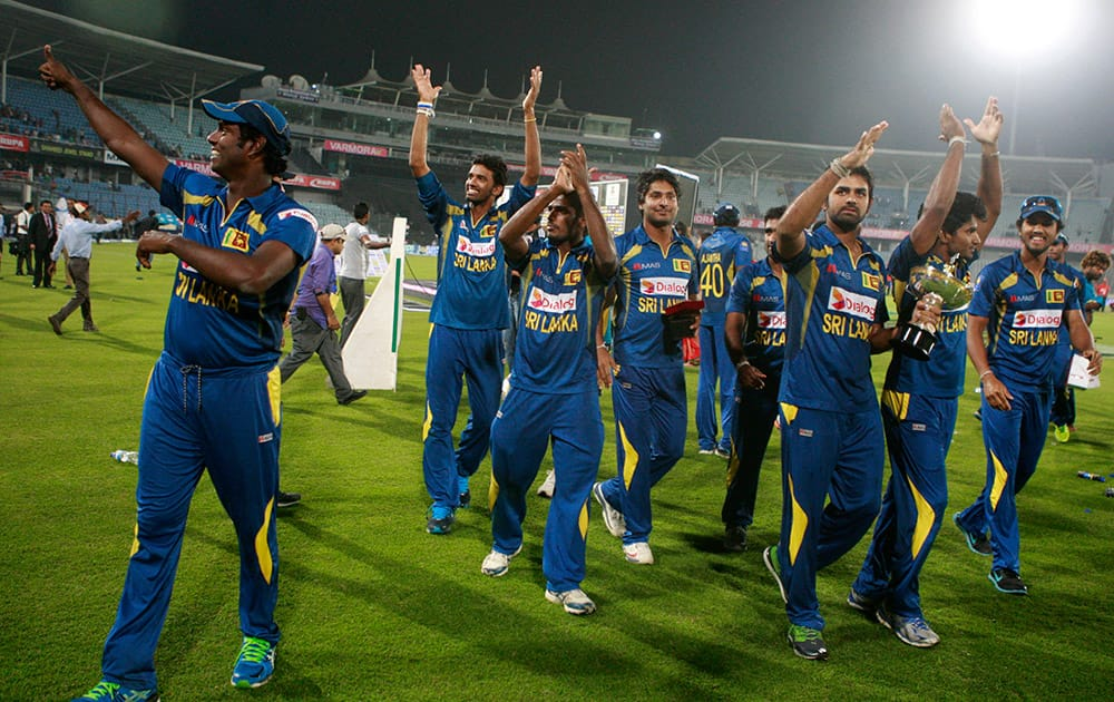 Sri Lankan cricketers acknowledge the crowd after winning the Asia Cup final match against Pakistan in Dhaka, Bangladesh.