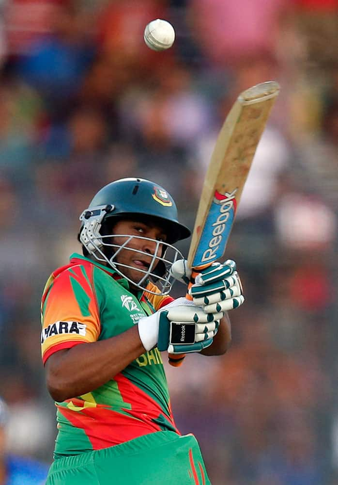 Bangladesh's batsman Shakib Al Hasan plays a shot during their ICC Twenty20 Cricket World Cup opening match against Afghanistan in Dhaka.