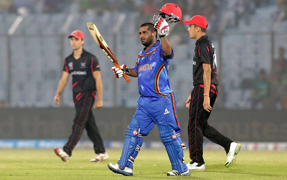 Afghanistan batsman Mohammad Shahzad acknowledges the crowd after scoring fifty runs during their ICC Twenty20 Cricket World Cup match against Hong Kong in Chittagong, Bangladesh.