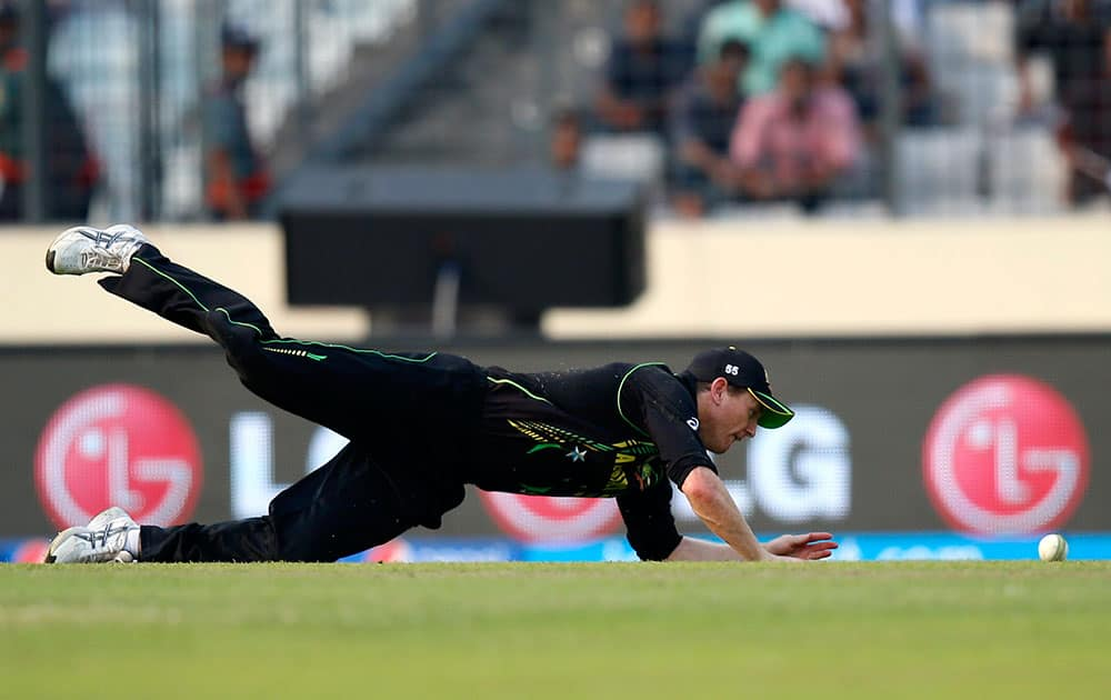 Australia's captain George Bailey misses to field the ball after a shot played by Pakistan batsman during their ICC Twenty20 Cricket World Cup match in Dhaka.