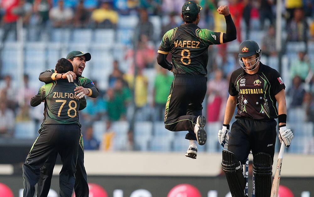 Pakistan players celebrate the dismissal of Australia's batsman Shane Watson, right, during their ICC Twenty20 Cricket World Cup match in Dhaka, Bangladesh.