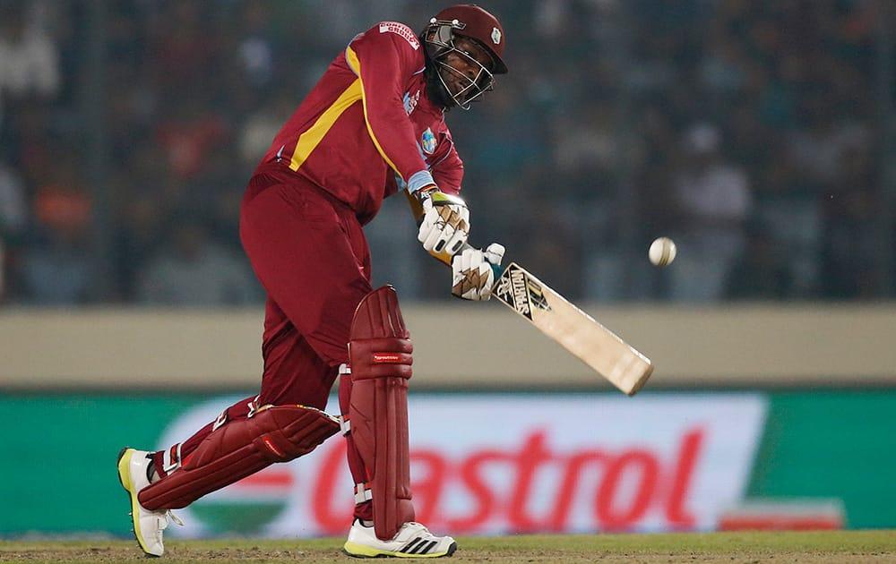 West Indies' batsman Chris Gayle plays a shot during their ICC Twenty20 Cricket World Cup match against Bangladesh in Dhaka, Bangladesh.