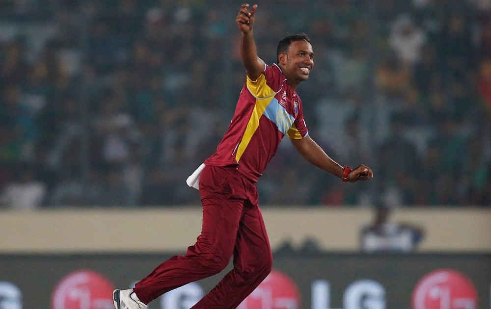 West Indies' bowler Samuel Badree celebrates the dismissal of Bangladesh batsman Mahmudullah during their ICC Twenty20 Cricket World Cup match in Dhaka, Bangladesh.
