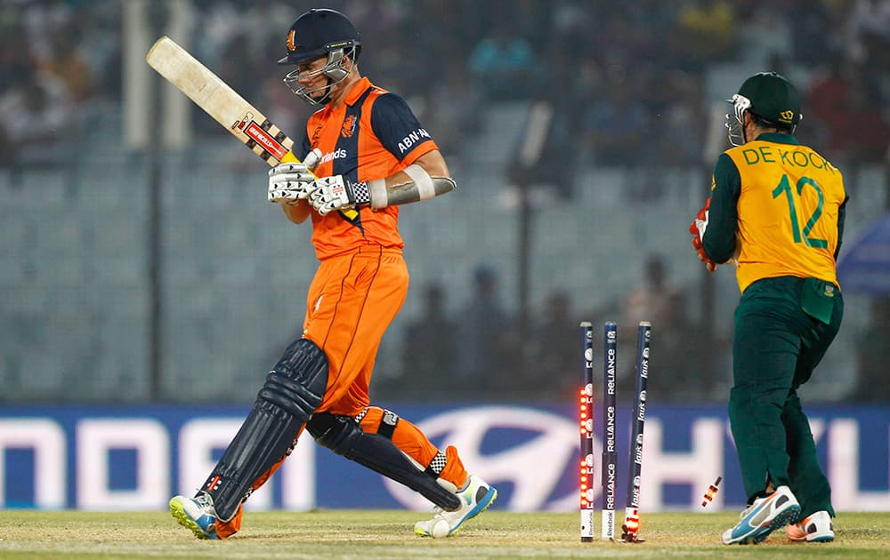 The bails fly off the wickets resulting in the dismissal of Netherlands' Tom Cooper during the ICC Twenty20 Cricket World Cup match against South Africa in Chittagong, Bangladesh.