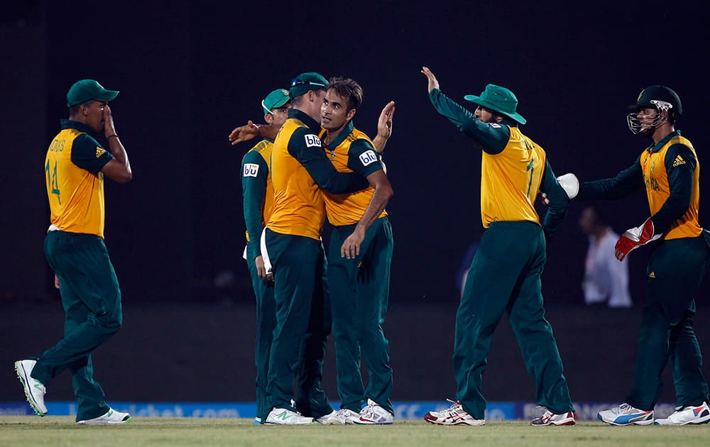 South African cricketer Imran Tahir celebrates with his teammates the dismissal of Netherlands' Pieter Seelaar during their ICC Twenty20 Cricket World Cup match in Chittagong, Bangladesh.