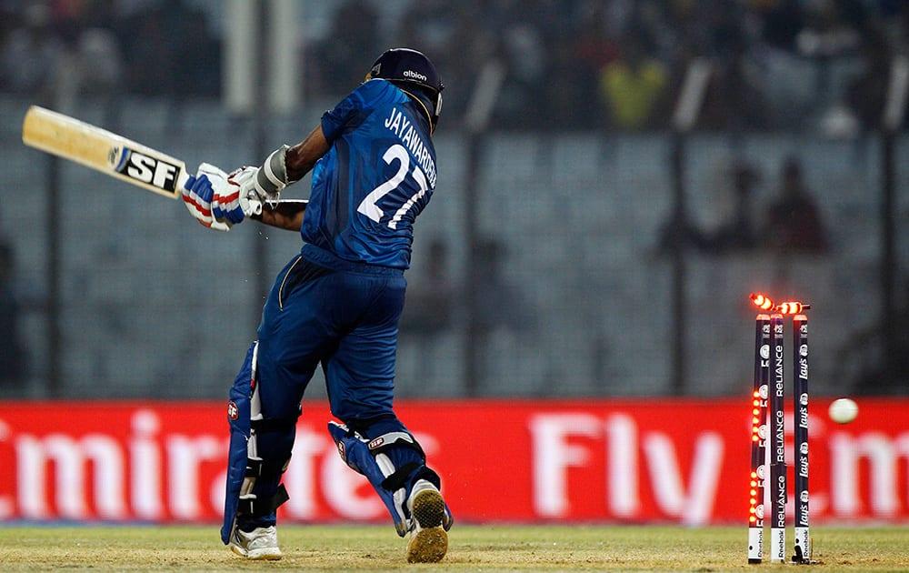 Sri Lanka's Mahela Jayawardena is bowled out by England's Chris Jordan during their ICC Twenty20 Cricket World Cup match in Chittagong, Bangladesh.