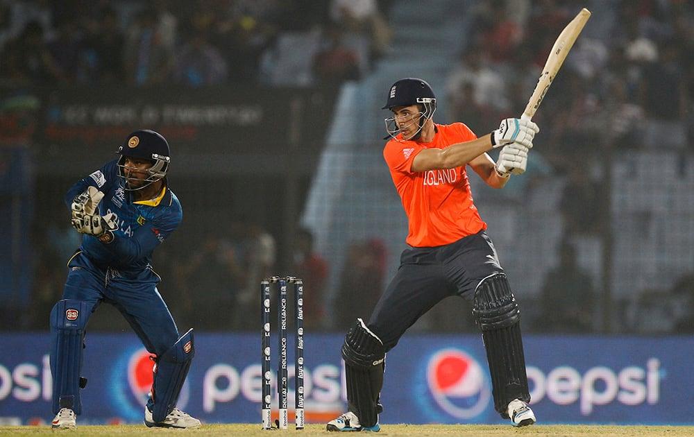 England's Alex Hales plays a shot, as Sri Lanka's Kumar Sangakkara follows the ball during their ICC Twenty20 Cricket World Cup match in Chittagong, Bangladesh.