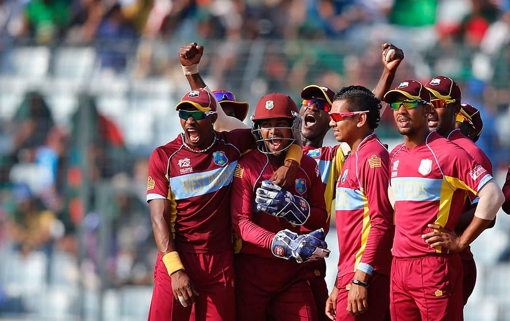 West Indies' players celebrate the dismissal of Australia's batsman Shane Watson during their ICC Twenty20 Cricket World Cup match in Dhaka, Bangladesh.