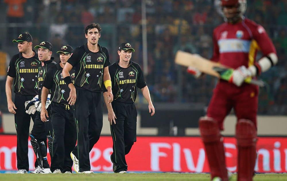Australia's bowler Mitchell Starc celebrates with teammates the dismissal of West Indies' batsman Marlon Samuels during their ICC Twenty20 Cricket World Cup match in Dhaka, Bangladesh.
