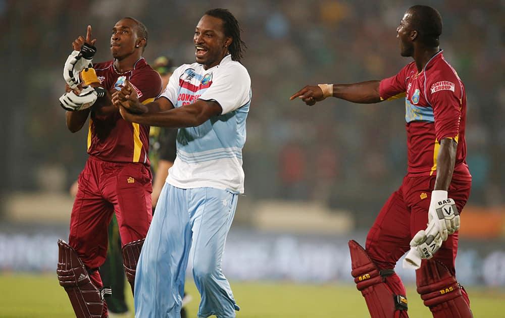 West Indies' Dwayne Bravo, Chris Gayle and captain Darren Sammy dance to celebrate their win over Australia in the ICC Twenty20 Cricket World Cup match in Dhaka, Bangladesh.