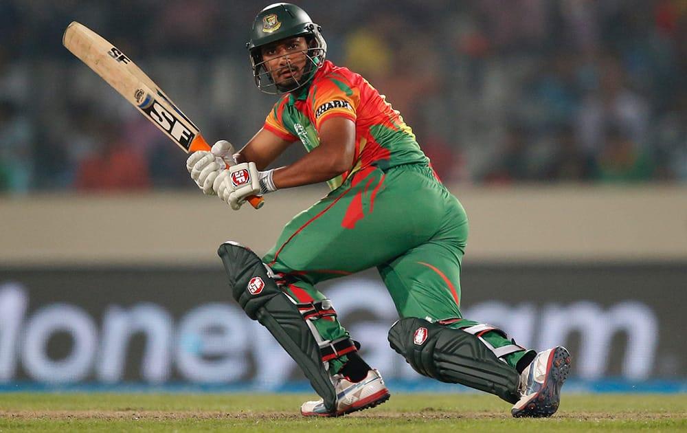 Bangladesh batsman Mahmudullah plays a shot during their ICC Twenty20 Cricket World Cup match against India in Dhaka, Bangladesh.