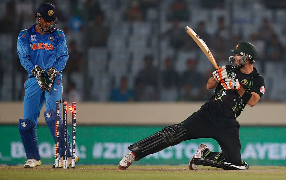 Australia's batsman Glenn Maxwell, right, is bowled out by India's bowler Ravichandran Ashwin during their ICC Twenty20 Cricket World Cup match in Dhaka, Bangladesh.