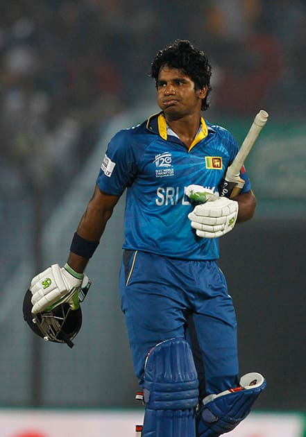 Sri Lanka's Kusal Perera walks back to the pavilion after his dismissal by New Zealand's Trent Boult during their ICC Twenty20 Cricket World Cup match in Chittagong, Bangladesh.