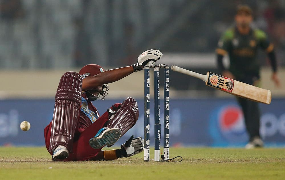 West Indies' batsman Dwayne Bravo falls on the ground after he was hit by the ball during their ICC Twenty20 Cricket World Cup match against Pakistan in Dhaka, Bangladesh.