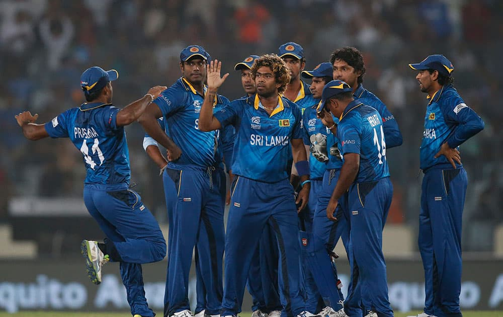 Sri Lanka's players celebrate the dismissal of West Indies' batsman Dwayne Smith during their ICC Twenty20 Cricket World Cup semi-final match in Dhaka, Bangladesh.