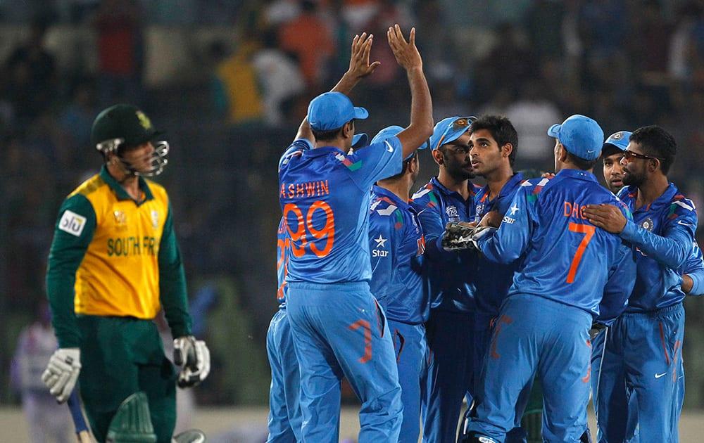 India's bowler Bhuvneshwar Kumar celebrates with teammates the dismissal of South Africa's batsman Quinton de Kock during their ICC Twenty20 Cricket World Cup semi-final match in Dhaka, Bangladesh.