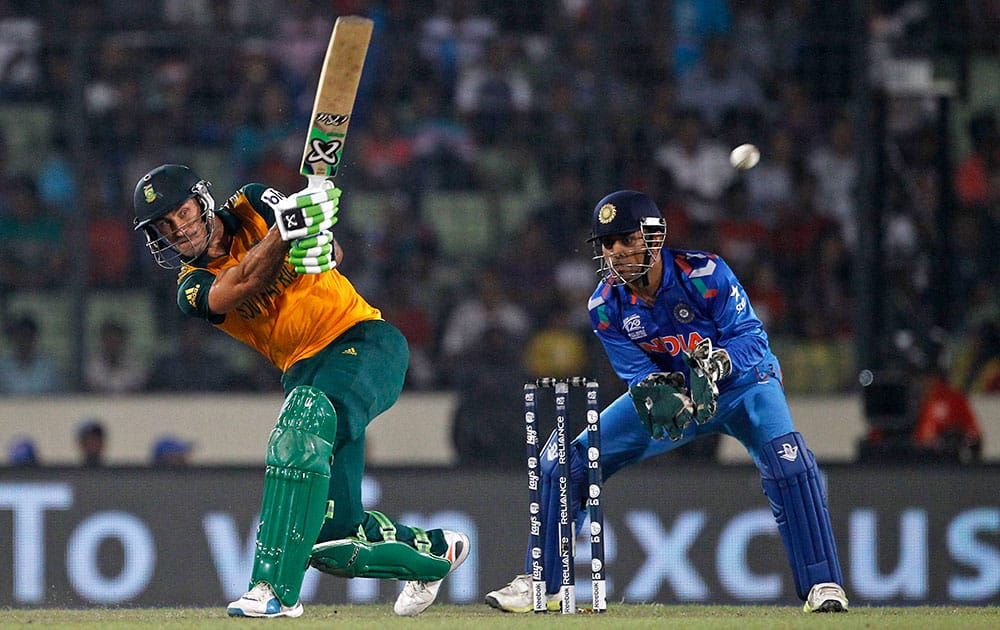 South Africa's captain Francois du Plessis, left, plays a shot, as India's captain Mahendra Singh Dhoni watches during their ICC Twenty20 Cricket World Cup semifinal match in Dhaka, Bangladesh.