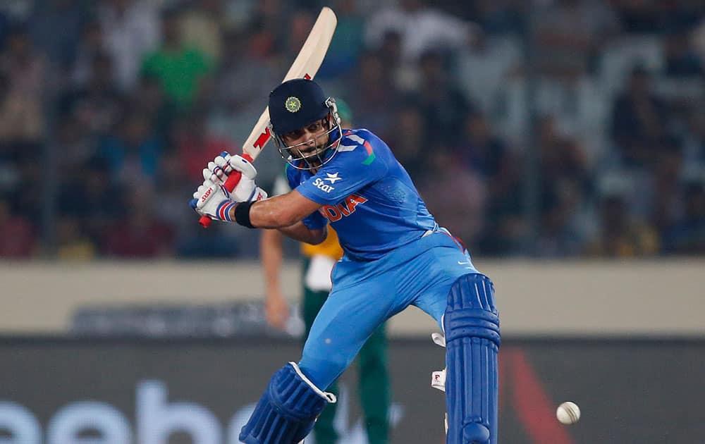 Virat Kohli plays a shot during their ICC Twenty20 Cricket World Cup semi-final match against South Africa in Dhaka, Bangladesh.