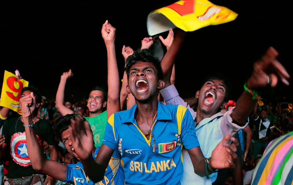 Sri Lanka cricket fans react as they watch on television in Colombo, Sri Lanka, the ICC Twenty20 Cricket World Cup final in Dhaka.