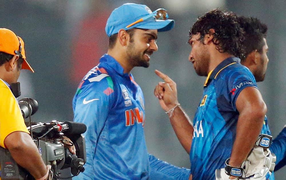 India's Virat Kohli, center, greets Sri Lanka's Kumar Sangakkara, front right, after Sri Lanka's win in the ICC Twenty20 Cricket World Cup final match in Dhaka.