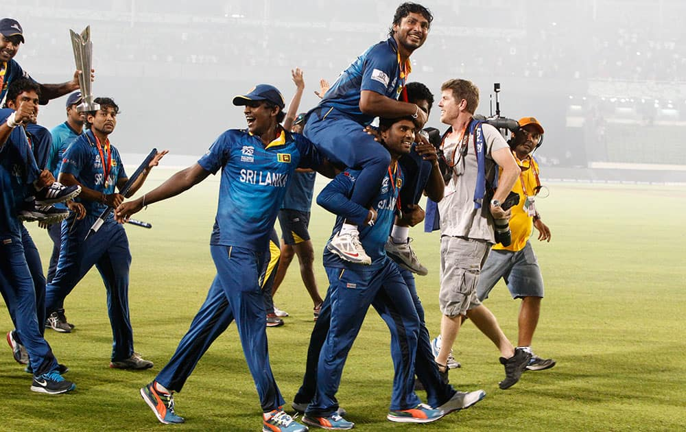 Sri Lanka's players lift Kumar Sangakkara, as they acknowledge the crowd after their win over India in the ICC Twenty20 Cricket World Cup final match in Dhaka.