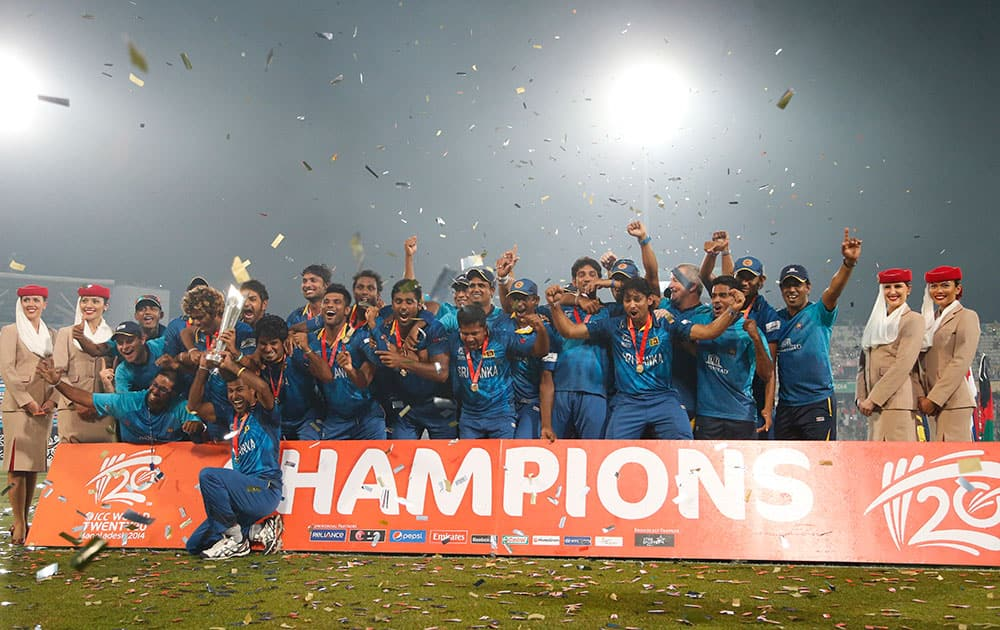 Sri Lankan players and support staff celebrate with the winners trophy after their win over India in the ICC Twenty20 Cricket World Cup final match in Dhaka.