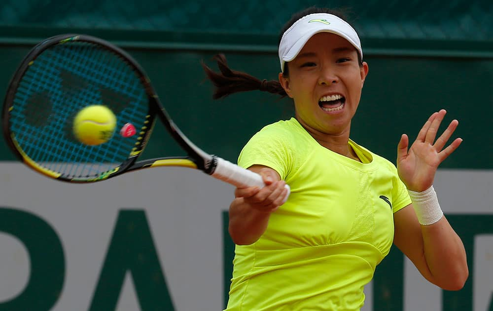 China's Zheng Jie returns the ball to Slovakia's Anna Schmiedlova during the first round match of the French Open tennis tournament at the Roland Garros stadium, in Paris.