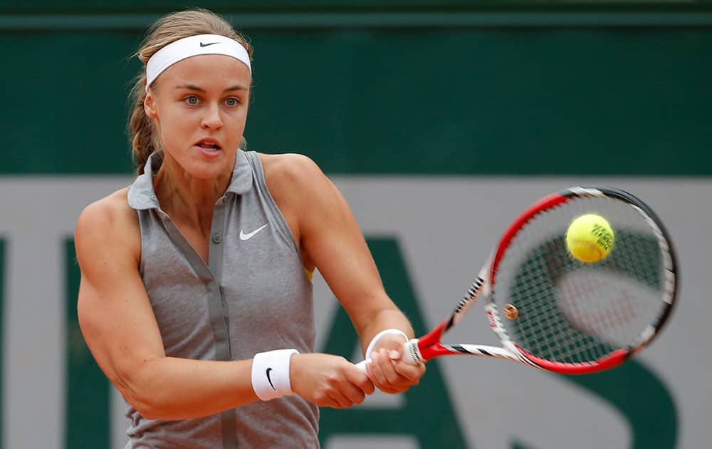 Slovakia's Anna Schmiedlova returns the ball to China's Zheng Jie during the first round match of the French Open tennis tournament at the Roland Garros stadium, in Paris.
