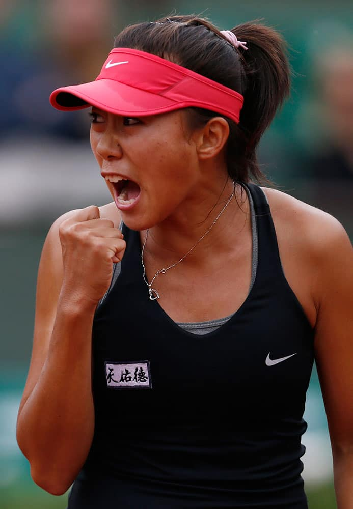 China's Zhang Shuai reacts as she plays Poland's Agnieszka Radwanska during the first round match of the French Open tennis tournament at the Roland Garros stadium, in Paris.