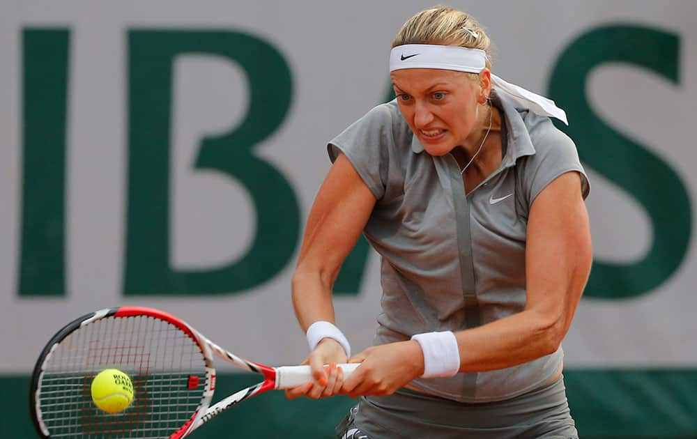 Petra Kvitova of the Czech Republic returns the ball to Kazakhstan's Zarina Diyas during the first round match of the French Open tennis tournament at the Roland Garros stadium, in Paris.