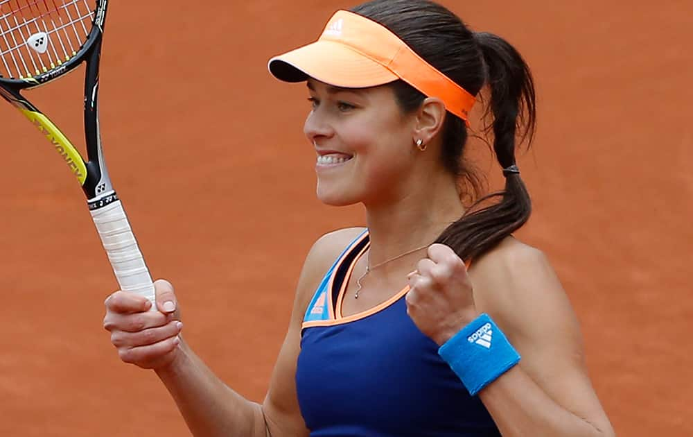 Serbia's Anna Ivanovic celebrates winning the first round match of the French Open tennis tournament in two sets against France's Caroline Garcia at the Roland Garros stadium, in Paris, France.