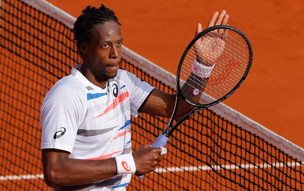 France's Gael Monfils celebrates winning the first round match of the French Open tennis tournament in four sets 6-2, 4-6, 6-4, 6-2, against Romania's Victor Hanescu at the Roland Garros stadium, in Paris, France.