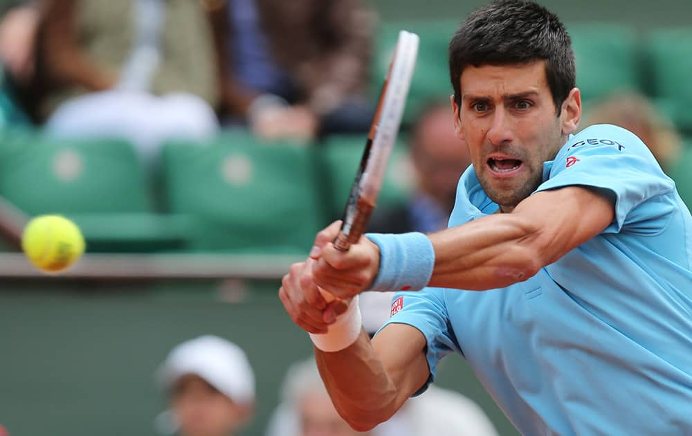 Serbia's Novak Djokovic returns the ball to France's Jeremy Chardy during their second round match of the French Open tennis tournament at the Roland Garros stadium, in Paris, France.