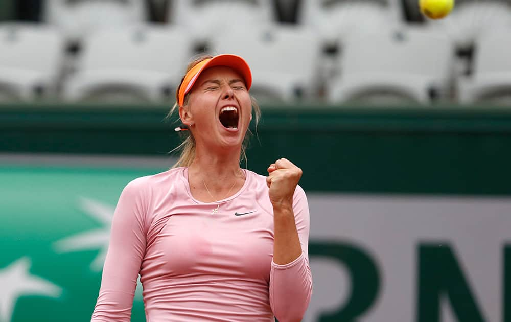 Russia's Maria Sharapova celebratesscoring a point during the fourth round match of the French Open tennis tournament against Australia's Samantha Stosur at the Roland Garros stadium, in Paris, France. Sharapova won in three sets 3-6, 6-4, 6-0.