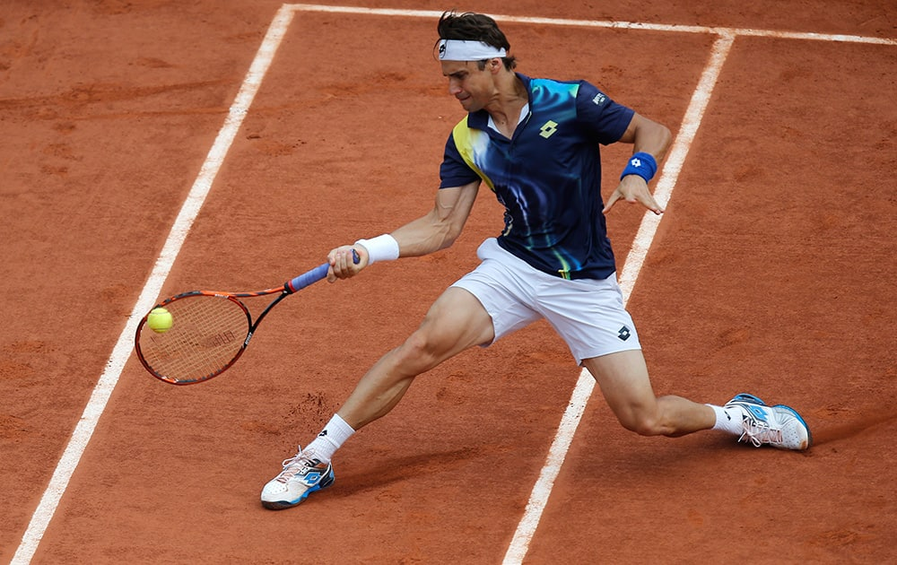 Spain's David Ferrer returns the ball during the fourth round match of the French Open tennis tournament against South Africa's Kevin Anderson at the Roland Garros stadium, in Paris, France.
