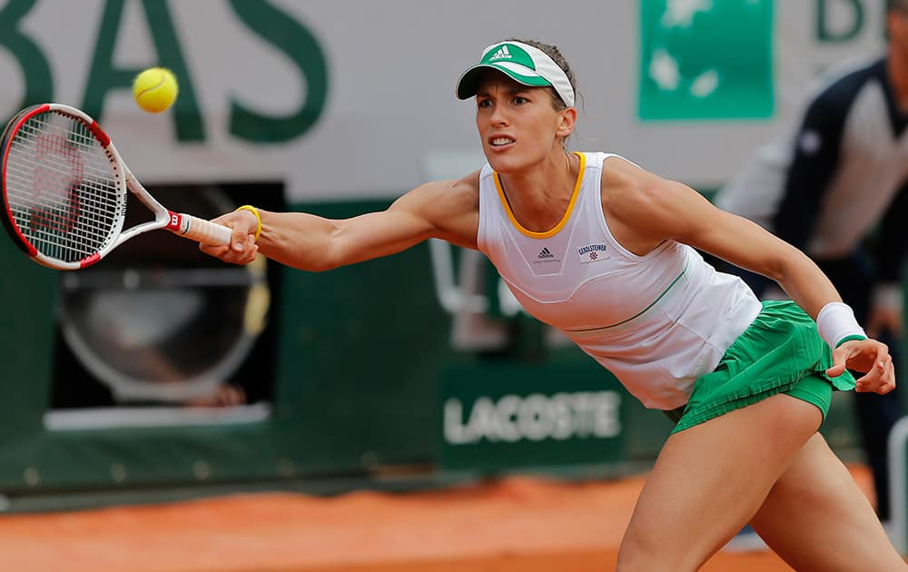 Germany's Andrea Petkovic returns the ball during the fourth round match of the French Open tennis tournament against Netherlands' Kiki Bertens at the Roland Garros stadium, in Paris, France. Petkovic won in three sets 1-6, 6-2, 7-5.