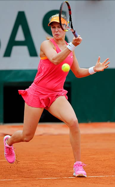 Canada's Eugenie Bouchard returns the ball to Spain's Carla Suarez Navarro during their quarterfinal match of the French Open tennis tournament at the Roland Garros stadium, in Paris, France.