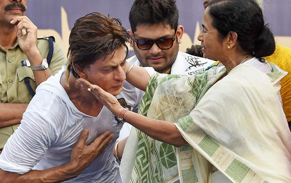 West Bengal Chief Minister Mamata Banerjee and Kolkata Knight Riders owner Shahrukh Khan during a felicitation ceremony for the team's victory at IPL - 7 tournament at Eden Garden in Kolkata
