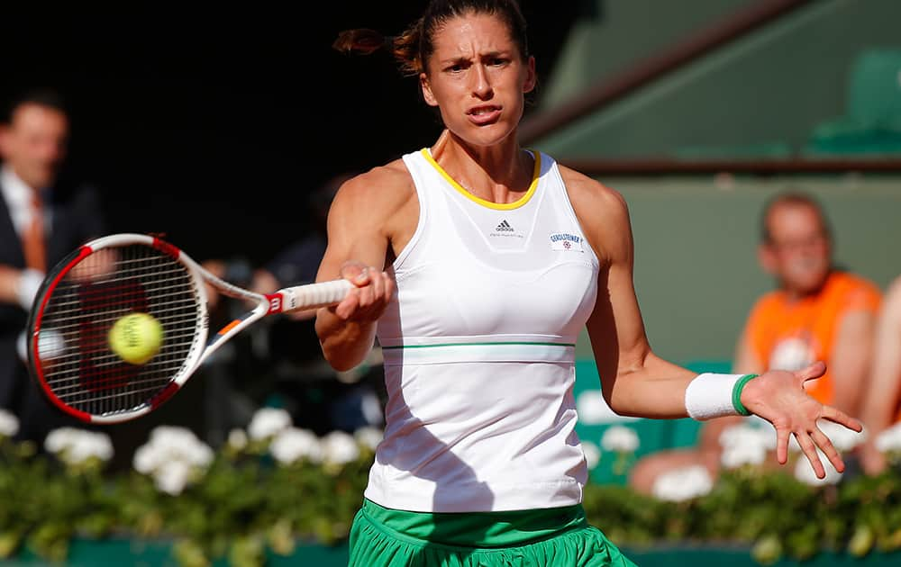 Germany's Andrea Petkovic returns the ball to Romania's Simona Halep during their semifinal match of the French Open tennis tournament at the Roland Garros stadium, in Paris, France.