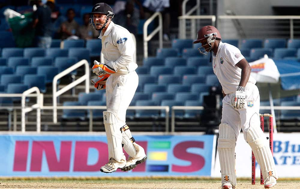 New Zealand's wicket keeper BJ Watling, left, jumps as appeals successfully for the LBW of West Indies' Shivnarine Chanderpaul for 24 runs during the second innings on the fourth day of their first cricket Test match in Kingston, Jamaica.