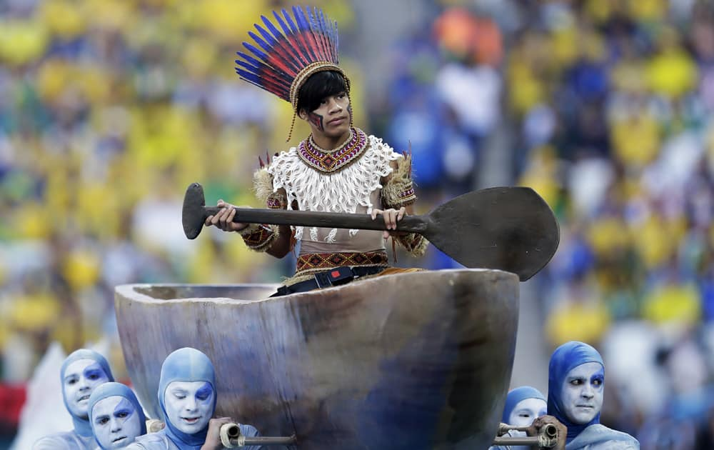 Actors perform during the opening ceremony before the group A World Cup soccer match between Brazil and Croatia, the opening game of the tournament, in the Itaquerao Stadium in Sao Paulo, Brazil.