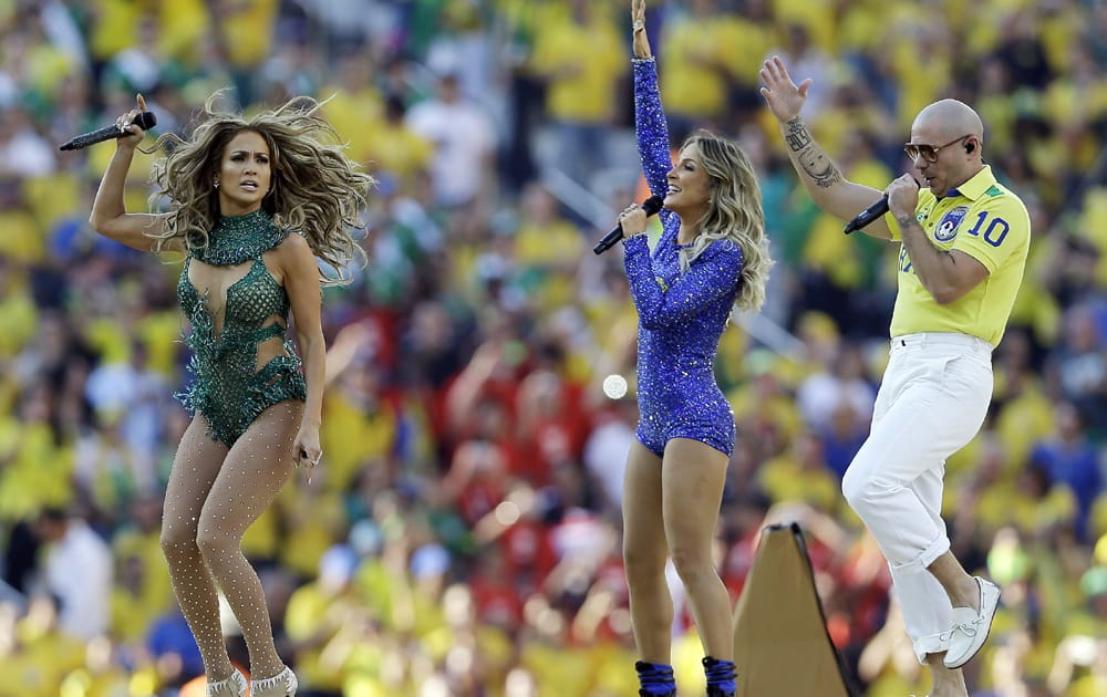 US singer Jennifer Lopez, left, rapper Pitbull and Brazilian singer Claudia Leitte perform during the opening ceremony ahead of the group A World Cup soccer match between Brazil and Croatia, the opening game of the tournament, in the Itaquerao Stadium in Sao Paulo, Brazil.