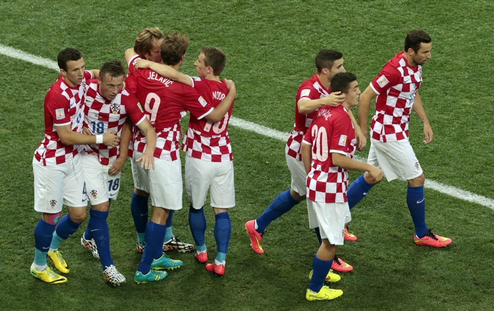 Croatia players celebrate after Brazil's Marcelo scored an own goal during the group A World Cup soccer match between Brazil and Croatia, the opening game of the tournament, in the Itaquerao Stadium in Sao Paulo, Brazil.