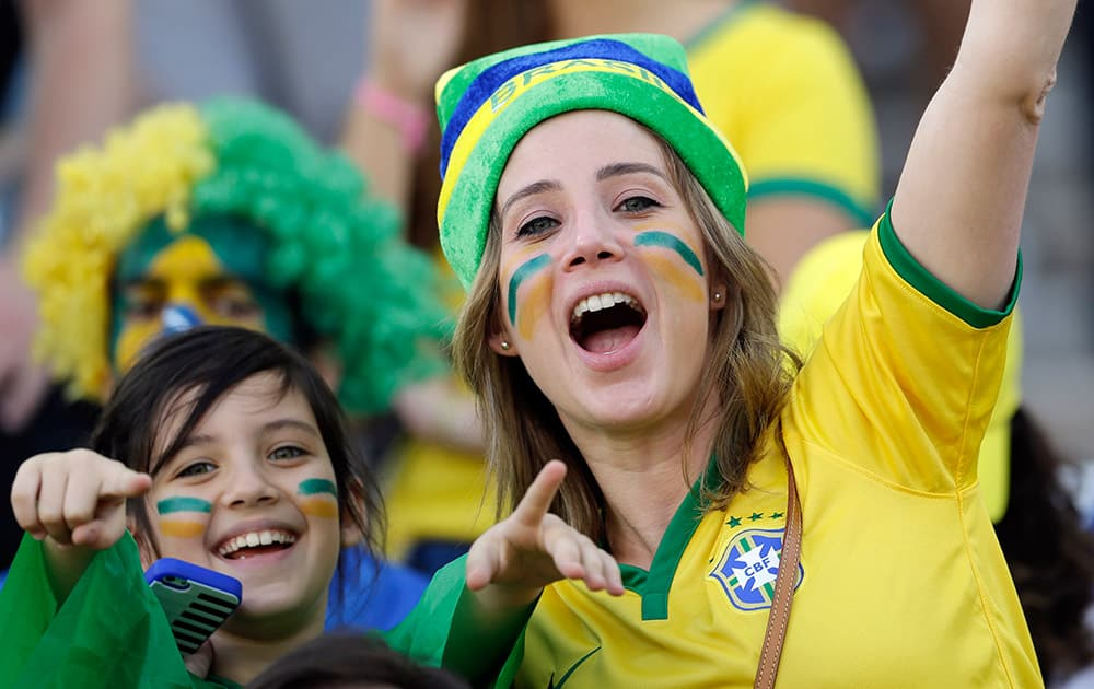Fans cheer before the start of the group A World Cup soccer match between Brazil and Croatia, the opening game of the tournament, in the Itaquerao Stadium in Sao Paulo.